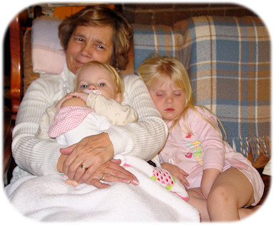 Caryl with Granddaughers, Chaya and Seanna.